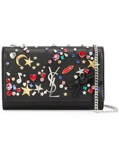 Shop Saint Laurent embellished 'Monogram' chain wallet in Stefania Mode from the world's best independent boutiques at farfetch.com. Shop 400 boutiques at one address.