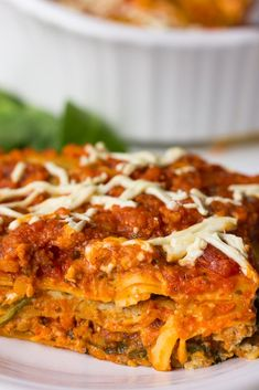 The world's BEST Vegan Lasagna! It's layered with a tofu-cashew ricotta, red lentil marinara and loads of fresh spinach. High protein and super satisfying!
