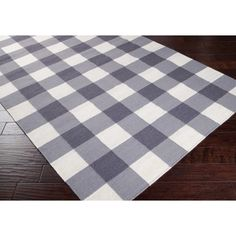 Aquilla Checked Rug in grey and white transforms any space into a cozy retreat. Aquilla rug offers classic cottage inspired style in a reversible flatweave.