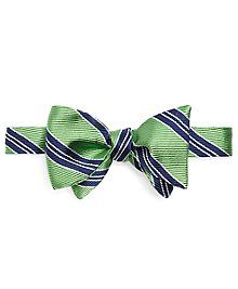 Butterfly bow tie made from pure silk woven in England. Self-tie. Dry clean. Made in the USA.