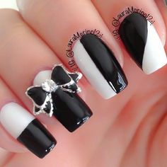 The Stripes are a bit too much, but I ADORE the bow!!! Black white nails, nailart ✿⊱╮