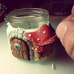 cover jar with clay decoration (maybe not a fairy house)