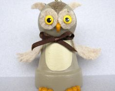 This lttle Puppy Bell is made from a small clay flower pot and has a bell inside. He is about 3 tall and has a chain collar. He is holding on to his favorite bone. You can set him on a shelf or hang him from a hook with his hanger. A great idea for a gift.  All of my flowerpot bells are original creations and are made and signed by me.  Thank you for checking out my shop.