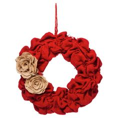 Welcome guests to your home with this charming burlap wreath, featuring rosette accents and a bold red hue.  Product: Wreath