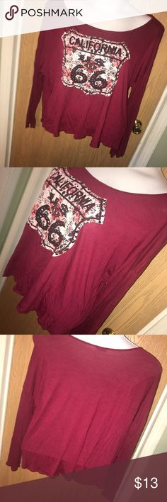 Burgundy CALIFORNIA graphic top Super cute burgundy top with floral California graphic front, has some studs and rhinestone detail. Good used condition. Size 3X. 100% rayon. 30 inches from armpit to armpit, 15 inches from armpit to hem. Wet Seal Tops