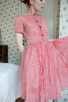 Sweet as can be! Sheer 1950s dress with red stripes and four cherry read vintage buttons and a working side metal zipper. Perfect Ice Cream