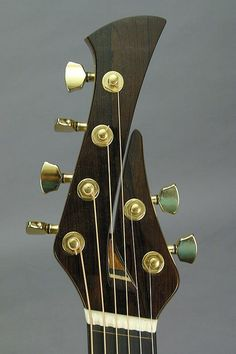 I like this headstock - it's custom, so I could customize it further and it could be my own!