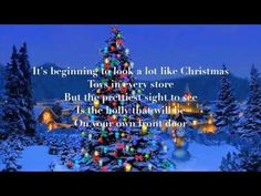 It's Beginning to look a lot like Christmas by Johnny Mathis with lyrics
