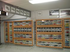 Display cabinets in the garage. Show off the little cars along with the full-sized one.