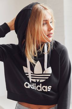 Shop adidas Originals Trefoil Cropped Hoodie Sweatshirt at Urban Outfitters today. We carry all the latest styles, colors and brands for you to choose from right here. Sweatshirt Outfit, Cropped Hoodie Outfit, Long Hoodie, Cropped Sweater, Adidas Crop Top Hoodie, Addidas Shirts, Adidas Trefoil Hoodie, Hoodie Sweatshirts, Hoodies