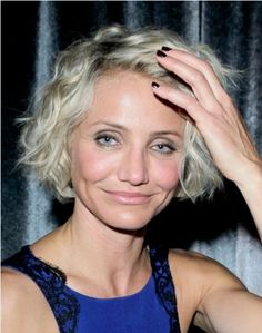 Cameron Diaz wearing a super chic blue dress by Monique Lhuilier and exposed her latest short wavy do at The Weinstein Company`s party after the Golden Globes.