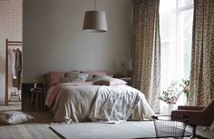 We love a relaxed bedroom, especially the dark neutral and blush tones. Fabrics and wallpaper from Scion's Levande collection.