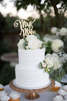 two tier white wedding cake / http://www.himisspuff.com/simple-elegant-all-white-wedding-color-ideas/9/