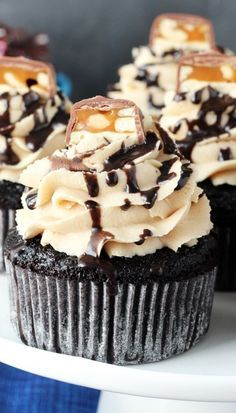 Snickers Cupcakes - The center tastes like a real Snickers candy bar.