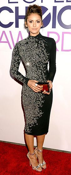 Nina Dobrev's gorgeous 2014 People's Choice Awards look: a long-sleeved, black, cocktail dress by Jenny Packham embellished with tiny beading on one side, with a clutch by Raowulf, and Charlotte Olympia sandals.