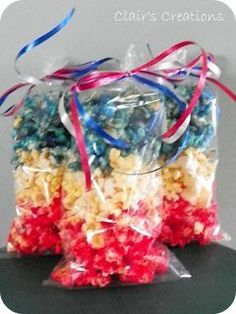 "Red, White, and Blue Popcorn: Few foods are as American as popcorn. Your 4th of July table will ""pop"" with color when you add this American-themed popcorn! Be sure to make several bags, as this will be popular with both kids and adults. This ""Jello Popcorn"" recipe is super easy to make and odds are, you have everything in your pantry already."