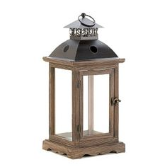Wholesale Large Monticello Candle Lantern.   The stately design of this candle lantern will dress up your home, indoors or out. Use the front latch to open the door and insert the candle of your choice. The clear glass panels and the antiqued frame are the perfect accent to beautiful candlelight, and the lantern can rest on its base or be hung from the top loop. http://www.wholesalemart.com/Wholesale-Candle-Lanterns-s/294.htm