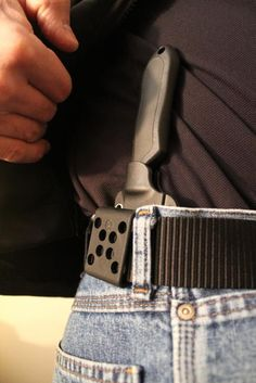 Concealed Knife sheath for fixed blade carry knife.
