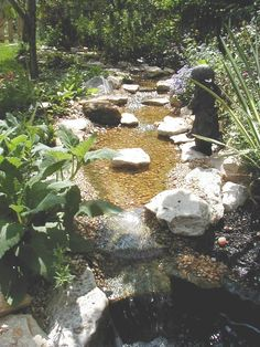 man-made creek from the hypertufa forum on gardenweb. More pictures and ideas included.