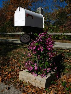 Mailbox decorated with artificial flowers by dakotaduff, via Flickr