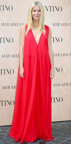 Gwyneth Paltrow nearly upstaged the Valentino Haute Couture fall 2015 show when she arrived in a diaphanous siren-red Valentino gown with a plunging neckline an airy silhouette that fluttered and billowed with her every move.