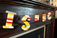 Name in LEGO. I think I might do this as part of his birthday deco next year.