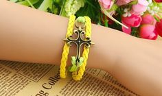 Cute Cross Embellished Yellow Knitted Charm Bracelet For Women Color: AS THE PICTURE Category: Jewelry > Bracelets   Item Type: Charm Bracelet  Gender: For Women  Chain Type: Link Chain  Style: Trendy  Shape/Pattern: Cross  #crossbraceletcharms #crossbracelet #charmsbracelet #womenbracelet #bridgat.com