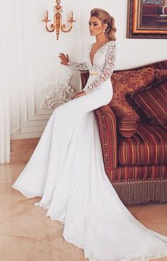 v neck long lace sleeves wedding dress / http://www.deerpearlflowers.com/deep-plunging-v-neck-wedding-dresses/