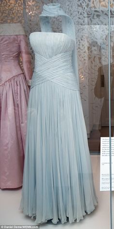 iana loved going to the movies and sometimes she also took fashion inspiration from what she watched. For this strapless dress, left, by designer Catherine Walker, she looked to Grace Kelly's gown in Alfred Hitchcock's 1955 classic To Catch A Thief
