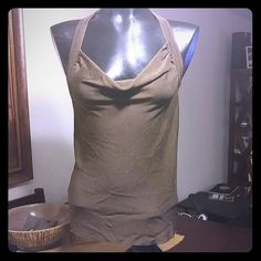 Bebe silk T-back scoop neck tank Olive green silken knit tank top. Dressy but can be worn with skinny jeans too. Size small. Like new. bebe Tops Tank Tops