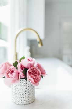 Pink roses by brass faucet | Studio McGee