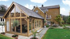 Julius Bahn specialises in building traditional oak-framed garden rooms from the finest quality oak, to create the perfect luxury extension for your home Metal Barn Homes, Metal Building Homes, Pole Barn Homes, Building A House, Garden Room Extensions, House Extensions, Oak Framed Extensions, Cottage Extension, Oak Framed Buildings