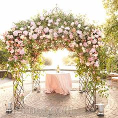Lush pink floral huppah // Jennifer Lindberg Weddings // Flowers: Petal Pushers // http://www.theknot.com/weddings/album/a-romantic-outdoor-wedding-in-san-antonio-tx-100482