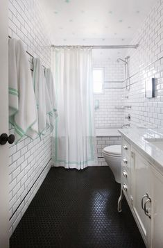 House Tour: A Vibrant Summer Home with Pops of Color | The Well Appointed House Blog  #powderroom #seafoam #green #white #stars #ceilinginspiration #blacktile #pennytiles
