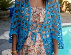 #FreeCrochetingPattern - This Hot Blue Shrug is super cute and the perfect addition to any summer outfit! Click the image to get the free instant download of the pattern!