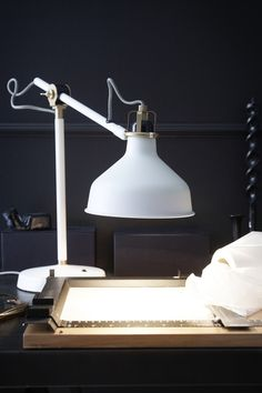 Add a touch of style to your home office or workspace! The IKEA RANARP work lamp is functional, stylish and provides a directed light that is great for reading. You can easily direct the light where you want it because the lamp arm and head are adjustable.