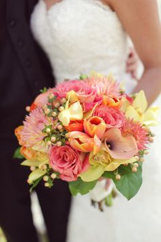 orange, peach and coral, add some belles of Ireland and an aqua ribbon
