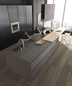 Contemporary kitchen. Like the drawer idea in the front for placemats, servery etc