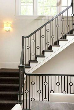 New England Stair Co. custom fabricated metal balusters on stairs off of  the kitchen and breakfast room. The handrail is painted wood and treads are  crafted ...