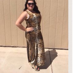 """LISTING Animal Print Maxi Very sexy! The bottom of skirt is mermaid style with a flair. Comes with gold belt. Pair with some sexy heels or flats. Measures 22"""" PTP and 55"""" length. Model says will fit up to a 2X Boutique Dresses Maxi"""