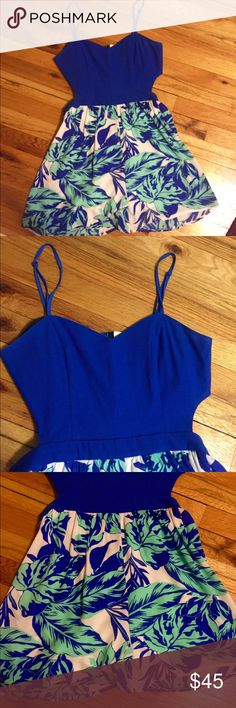 Blue Floral Romper Beautiful blue and floral romper, perfect for Spring Break or vacation! Cobalt blue top with blue, green and white tropical flora print on the bottom. Open back detail. Top is stretchy and hugs your chest. Bottom is very flowy and flattering for all body types. ONLY WORN ONCE on vacation! Basically brand new! Jealous Tomato Dresses Mini