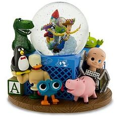 "Toy Story Musical Snow Globe Plays ""You've Got A Friend In Me"" Features: Woody, Buzz Lightyear, Rex, Hamm, Penguin, Lenny, Aliens, Toy Soldiers, and Baby Face."