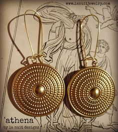 Evoking classical ancient elegance, these gorgeous raw brass drops have a dotted circular design that bring to mind the shield of the Greek goddess ATHENA. Bold and beautiful, strong and stunning. By designer nuit moore/la nuit designs  http://www.lanuitjewelry.com/store/p12/ATHENA.html  greek goddess jewelry ancient greco roman style