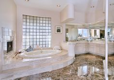 While I don't like the total lack of color; I am a sucker for that bathtub with the fireplace.