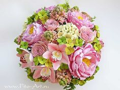 Omg i cant believe this is made of clay!! Orchids and peonies