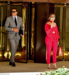 Rounding out the look: A scarlet choker joined an ensemble of accessories that included aviator sunglasses and a camel-colored leather purse that complemented her nude stilettos