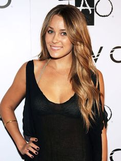Loose, rolling waves give Lauren Conrad's ultra-long hairstyle a soft texture.