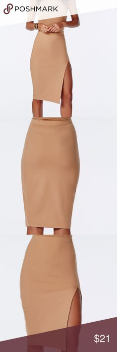 """Missguided Thigh Split Scuba Midi Skirt Work it like a boss in our smokin' hot thigh high split scuba midi skirt. in stretch fabric with a high waist the body con beaut really flatters. team with a white crop top and nude heels for minimal styling. (No size show on the label & added measurements so I assume it will be XS) Flat across @ waist: 11"""" (elastic waist) lenght: 25"""". Split lenght @ top to hem: 15"""". Stretchable material. NWT Missguided Skirts Midi"""