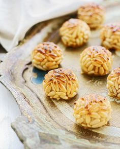 Panellets are small pastries made of pine nuts, almonds and sugar with different shapes and flavors, eaten during la Castanyada, which Catalans celebrate on 1 November instead of Halloween. Their origin is Jewish, before the Middle Ages, but the tradition of castanyada is much older.