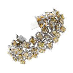34 Carats of  Fancy Intense Yellow Diamonds White Gold Bracelet   From a unique collection of vintage modern bracelets at http://www.1stdibs.com/jewelry/bracelets/modern-bracelets/